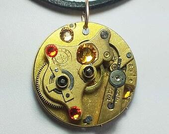 Steampunk  pendant,   golden pocketwatch mecanism, yellow and orange  flat  Swarovski  cristal cabs, bronze colour  chain