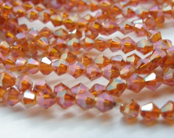 glass crystal 4 mm bizone 100 beads has lustrous transparent orange faceted