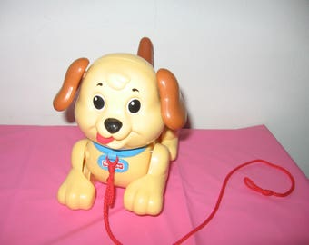 Vintage Fisher Price Pull Dog Yellow Plastic With Brown Ears And Tail Wagging Tongue - Vintage Fisher Price Pull Dog Toys