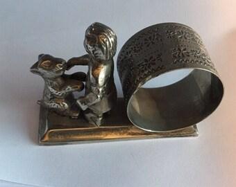 Meriden figural napkin ring made of base metal