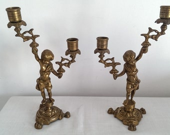 Pair of ornate french cherub double candle holders