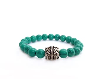 Turquoise Layering Bracelet - Magnesite Beads - Silver Tibetan Focal Bead - Teal Blue - Bohemian Stretch Bracelet