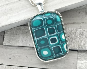 Teal mod style polymer clay pendant