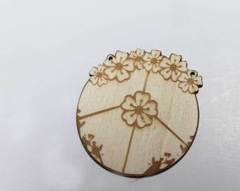 A wooden patterned flowers & peace pendant