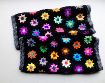 Crochet black gaiters and multicolored flowers