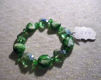 Green Flat Beads with a swirl through them and Faceted green flat beads with small crystal beads  Stretchy Bracelet - Item 250