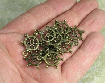 Tiny Tibetan dharma wheel brass pendants