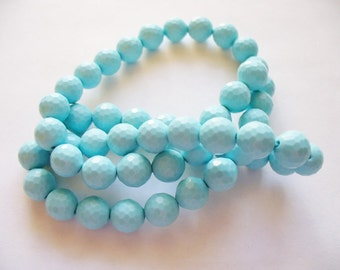 Synthetic Turquoise Faceted Round 8MM