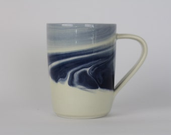 MUG Blue Marbled Mug. Blue ceramic/pottery drinking vessel.