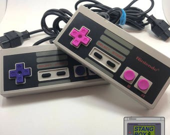 Nintendo Entertainment System (NES) controllers with custom buttons