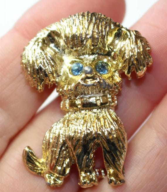 A Really Silly Looking Vintage Goldtone Doggie Brooch with light Blue Rhinestone eyes and Poofy hair about 1.5 inches Crazy Funny Cute