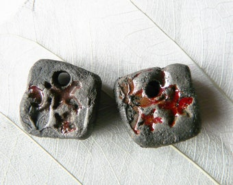 Duo charms raku pottery, flower, red enamel and black print