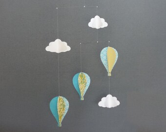 Blue and mustard yellow mobile white clouds and balloons in patterned papers