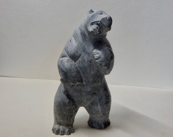 Inuit Eskimo Art soapstone Carving with furious teeth, abut 7x5x4, signed T. Ekak, very heavy