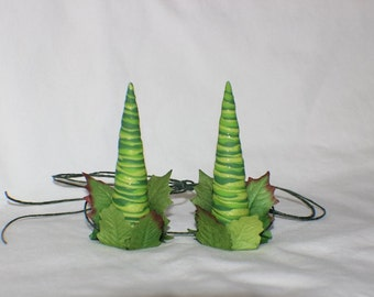Green twisted leafy horns