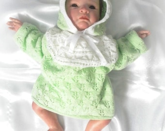 Hand knitted baby hat and jacket