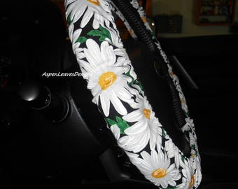 Steering wheel cover with large white daisies. Fully lined. Seat belt covers. Matching key fob. Floral car accessories. Large daisy.