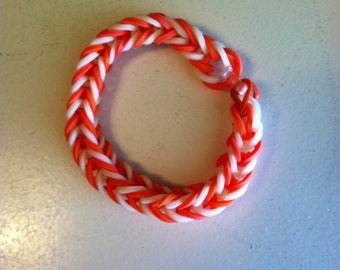 "GO VOLS!  This is a Fishtail-style Bracelet Made In the Colors of the University of Tennessee, Orrange and White.  This Is A 6"" Bracelet."