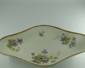 White porcelain dish with handpainted violets and gold trim