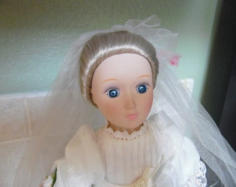 """Bride doll from different eras series.  14"""", with stand.  Made in Taiwan. Empire bride, Margaret. Blonde hair and blue eyes"""