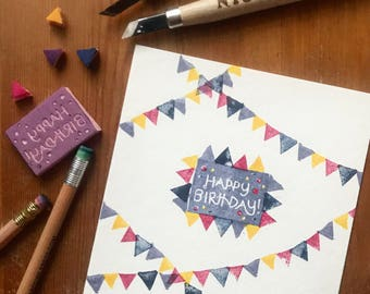 Handprinted happy birthday card with bunting flags