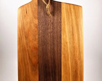 Handmade cherry and walnut cutting board with handle