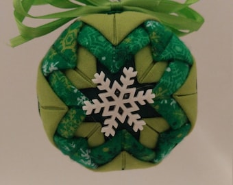 Green folded fabric handmade ornament with snowflake decoration