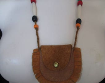 "Handmade leather purse necklace on leather cord measures 3"" x 3/12"""
