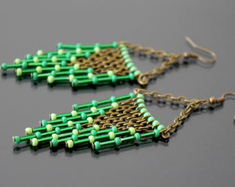 Long green earrings.