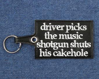 """Driver Picks The Music Shotgun Shuts His Cakehole Key Chain –4"""" x 2.25"""" Driver Picks The Music Vegan Leather Keychain"""