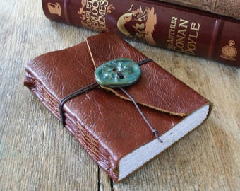 """Leather Journal . Pearl Buck quote: """"Inside myself is a place where I live alone..."""" handbound . copper brown & ceramic button (320pgs)"""