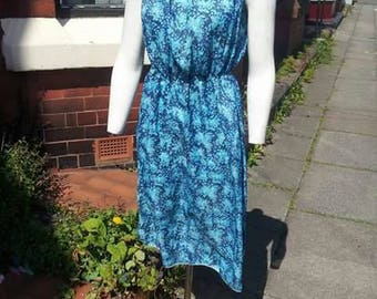 Jazzy blue 1970s patterned disco holiday festival dress