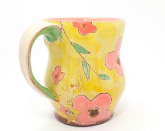Yellow floral Earthenware mug. Wheel thrown, food safe mug made by Kaitlyn Brennan / Brennan pottery. This is a big mug perfect for coffee