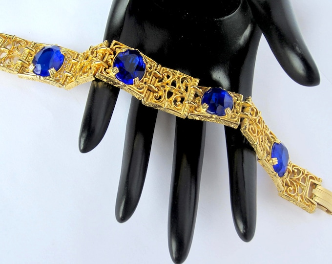 Regal Royal Blue Crystal gold tone, scroll hinged Panel Bracelet ~designer quality, vintage costume jewelry