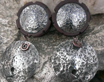 Dangle plugs pounded steel