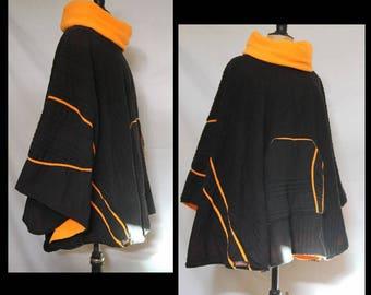 Fleece lined poncho, black and orange