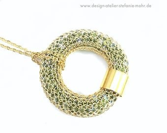 wire crochet gold coloured donut/ring pendant filled with sparkling green glass beads