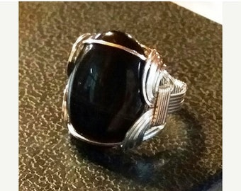 End of May Sale Nice Gents ring of sterling silver is a sardonyx in onyx stone could be unisex.  Traditional Pharoah Ring styling.  Size 11.