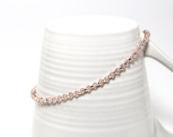 Delicate ankle bracelet in stainless steel with pink crystals and silver glass