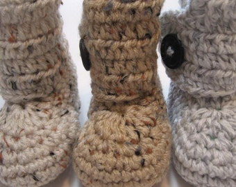 Baby booties.  Infant sizes.  One button ankle boots.  Unisex booties.  Gender neutral booties.  Ankle boots for baby boys or baby girls.