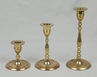 Three Brass Candle holders Round base 3 heights Brass candle stick holders Lathe style turned candle sticks Yellow brass