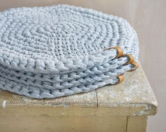 gray crocheted round seat cushion perfect for autumn