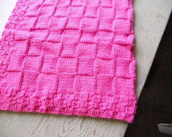 Hand knitted baby blanket in  pink. It also comes in a variety of colors.