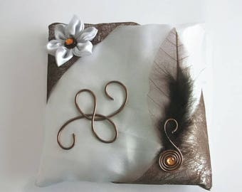 Brown and white wedding ring cushion