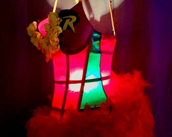 Hand Made Tramp Lamp crafted from Red and Green Robin Super Hero Bustier Trimmed in Yellow Roses at bust line and lush red feathers