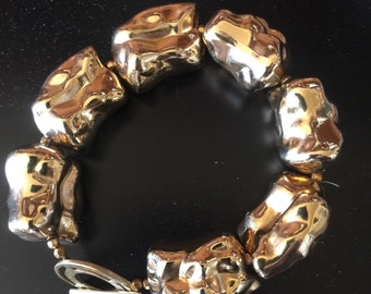 Gold tone plating over resin beads - very light weight with toggle clasp