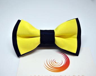 Handmade bow tie for chid made up of blue and yellow satin fabric.