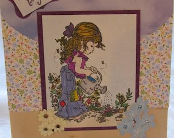 Little girl watering her flower garden Birthday Card,