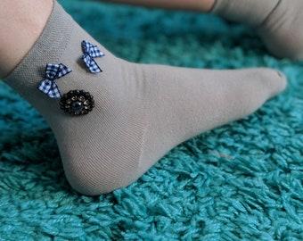 Hand-made socks with Swarovski button