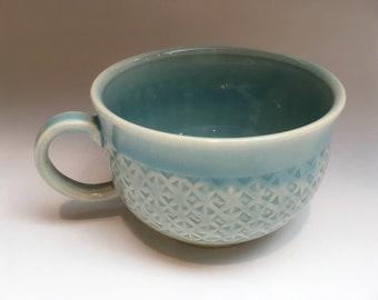 Stamped celadon blue teacup
